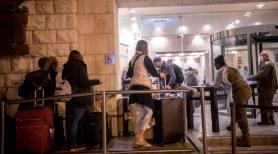 Israel nixes quarantine hotels after some inside try to escape and others cause uproar