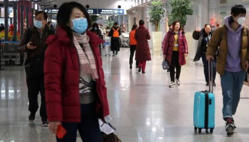 China restricts overseas travel; Macau orders virus testing after first cases in months